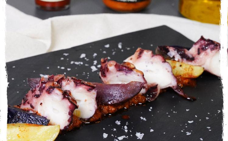 Pulpo braseado con romesco y patatas